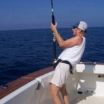 Pat Woodard is a happy angler while fighting a sailfish baitfish aboard her boat Christina Lynn between Papanoa and Acapulco. January, 2007.