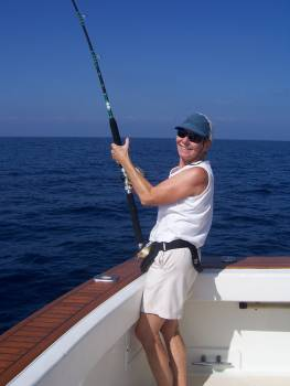 Pat Woodard working on a sailfish baitfish aboard her boat Christina Lynn. The fish was eventually tagged and released. January 2007.