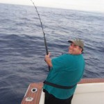Bob Vanian hooked to am estimated 350 pound blue marlin off Barra Navidad aboard the Christina Lynn. It is early in the standup fight and the pain and exhaustion ahead has yet to set in (I am still smiling). Jan.2004