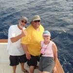 Bob Woodard, Pat Woodard and Bob Vanian celebrating the catch and release of Bob V's black marlin on 20 lb. test. January 2007.