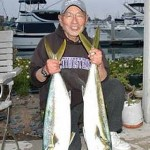 Harry Okuda of the Alfresco III with a couple of 14 pound yellowtail caught at the Coronado Islands aboard the San Diego out of Seaforth Sportfishing on April 30, 2007