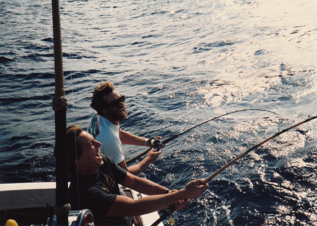 Circa mid 1980's.  One of my all time favorite photos....John Everett and Charlie Pravel are hooked up to 80 pound class bigeye tuna on 8 foot rods and getting punished...the bigeye unexpectedly came through in an albacore stop and all they could do was laugh about how much they were getting their butts kicked by the big fish on such long rods.  If I recall correctly they both got their fish.   What great fun we had!
