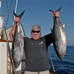 Carl Robbins hoisting a couple of nice  bluefin caught aboard the Christina Lynn on May 28, 2015